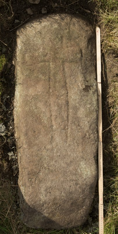 View of recumbent cross slab. Available lighting. (with scale)