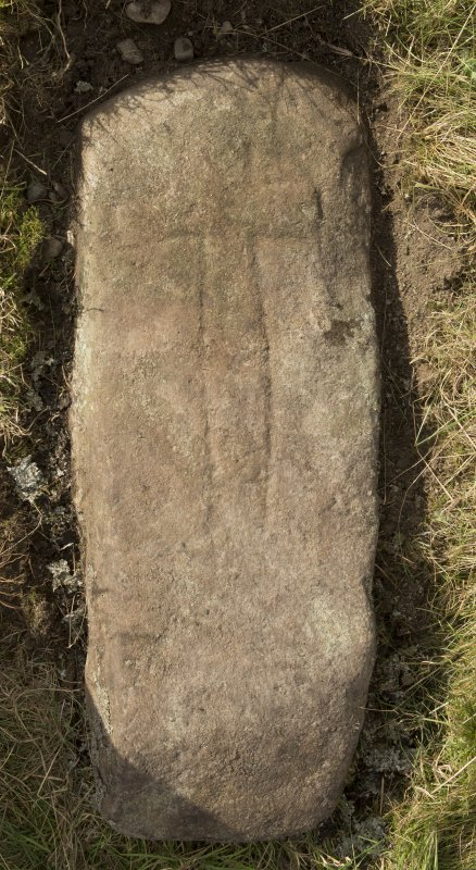 View of recumbent cross slab. Available lighting.