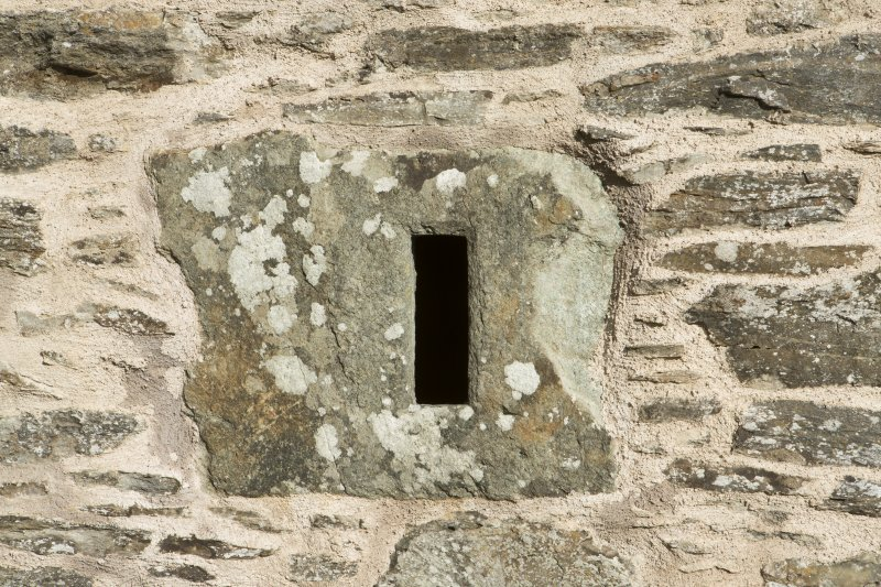 Detail of small monolithic window.