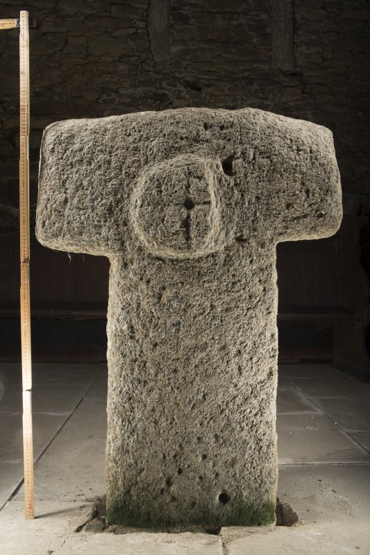 View of cruciform stone situated inside church. Peripheral lighting. (with scale.)