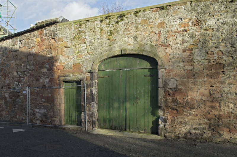 Arched entrance to coach house, view from west