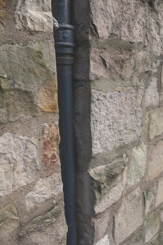 Detail of recessed downpipe in stonework at ground floor level on former Maltings, 136-138 Calton Road, Edinburgh.