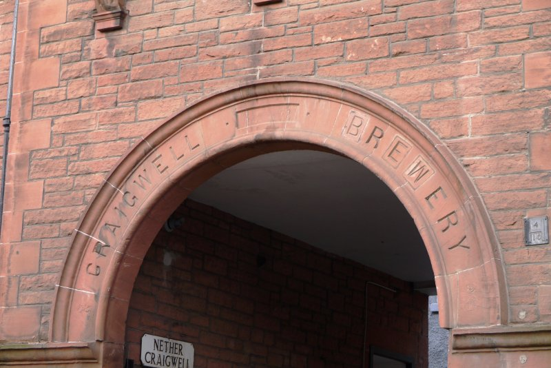 Detail of carved name above pend at former Craigwell Brewery, 65 Calton Road, Edinburgh.