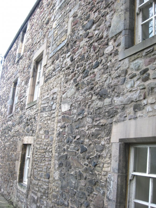 View of altered doorway/window openings on west elevation of Cadell House, Panmure Close, 129 Canongate, Edinburgh.