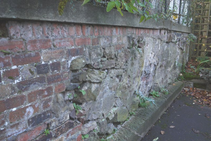 Detail of brick and stone walling marking boundary between Canongate Manse, Reid's Court, 95 Canongate and Brown's Close, 85 Canongate, Edinburgh.