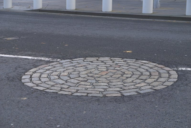 Detail of circular cobbled marker for former site of Girth Cross, Canongate, Edinburgh.