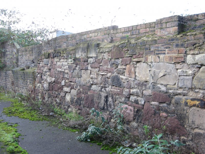 Detail of part of south boundary wall to site of former Gasworks, New Street, Edinburgh.