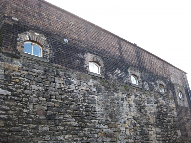 View of part of boundary wall to Gasworks, New Street, Edinburgh, off Old Tolbooth Wynd.