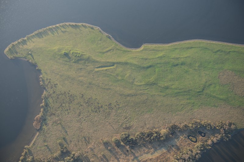 Oblique aerial view of St Serf's Island centred on the Priory Church, looking S.