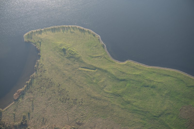 Oblique aerial view of St Serf's Island centred on the Priory Church, looking SE.