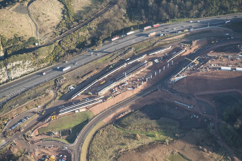 Oblique aerial view of the construction works for the approach to the Queensferry Crossing on the N bank, looking E.