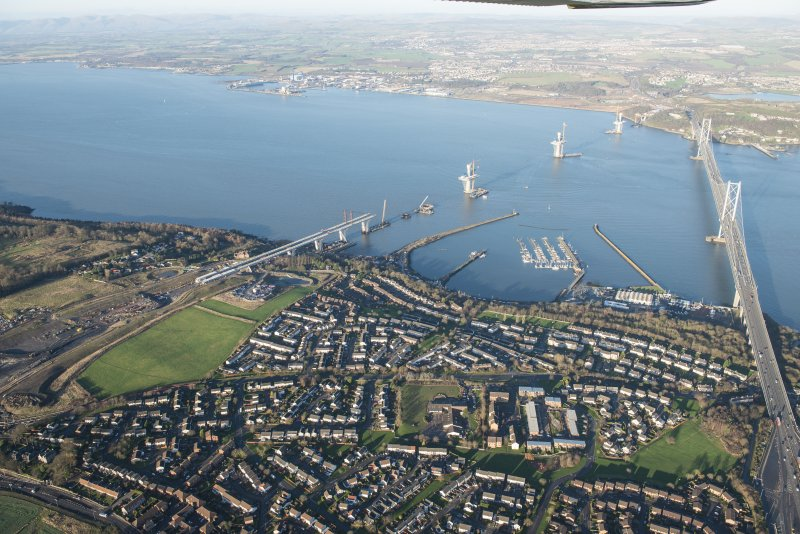 General oblique aerial view of the Forth Road Bridge and the construction of the Queensferry Crossing, looking NNW.