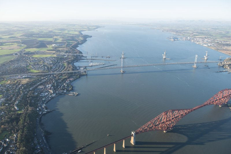 General oblique aerial view of the Forth Bridge, the Forth Road Bridge and the construction of the Queensferry Crossing, looking WNW.