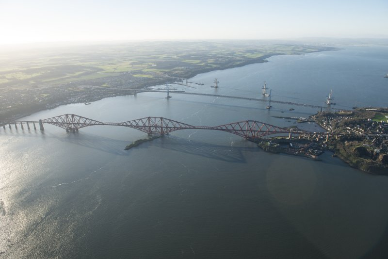 General oblique aerial view of the Forth Bridge, the Forth Road Bridge and the construction of the Queensferry Crossing, looking WSW.