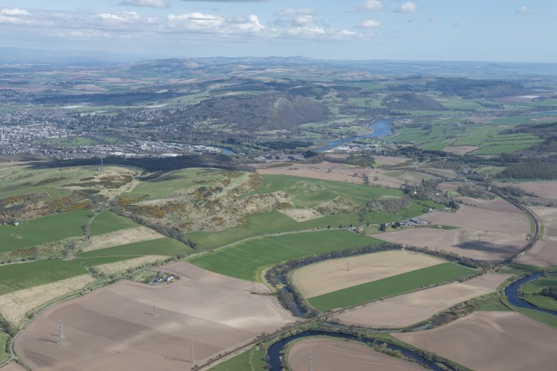 General oblique aerial view with Perth and the Friarton Bridge in the middle distance, Strathmore beyond and the Tay extending to the right, looking NE.