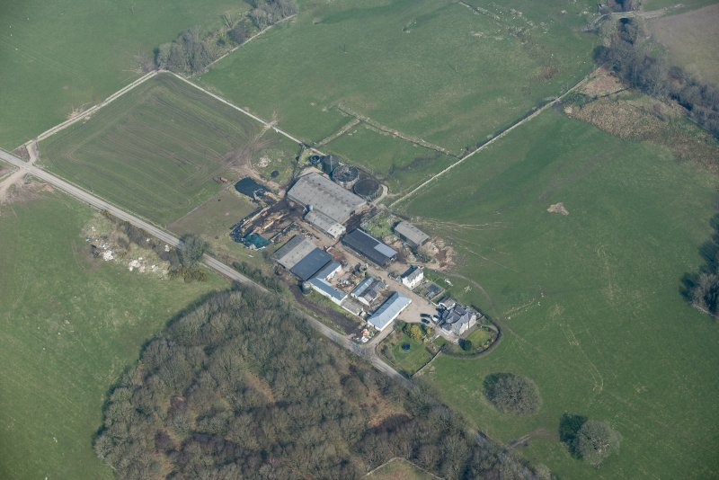Oblique aerial view of Auchenskeock Castle and Farm, looking N.