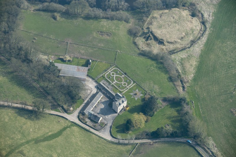 Oblique aerial view of Buittle Place Tower House and Buittle Castle, looking E.