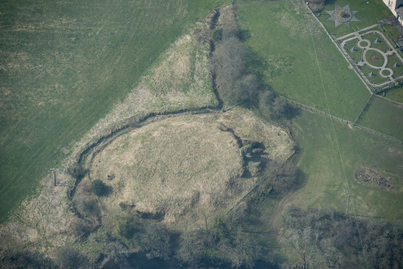 Oblique aerial view of Buittle Castle, looking SW.