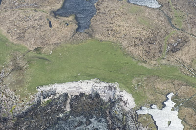 Oblique aerial view of the farmstead and lazy beds at Loch na Gile on Tiree, looking ESE.