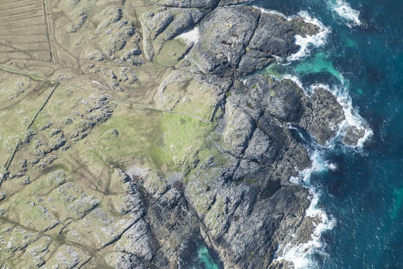 Oblique aerial view of Dun Boraige Moire on Tiree, looking SW.