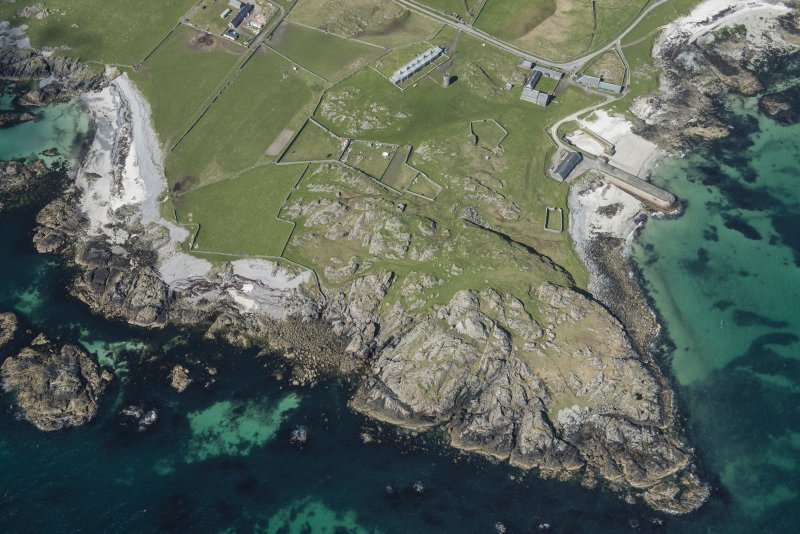 Oblique aerial view of Hynish Lighthouse shore establishment on Tiree, looking WNW.