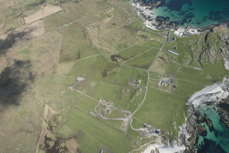 General oblique aerial view of Hynish on Tiree, looking NNE.