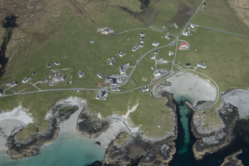 General oblique aerial view of Scarinish on Tiree, looking NW.