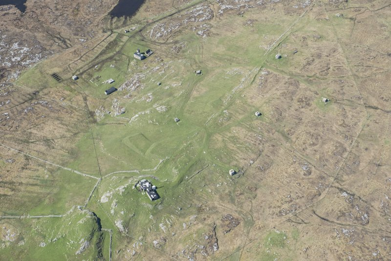 Oblique aerial view of Bheinn Gott radar station on the Isle of Tiree, looking W.
