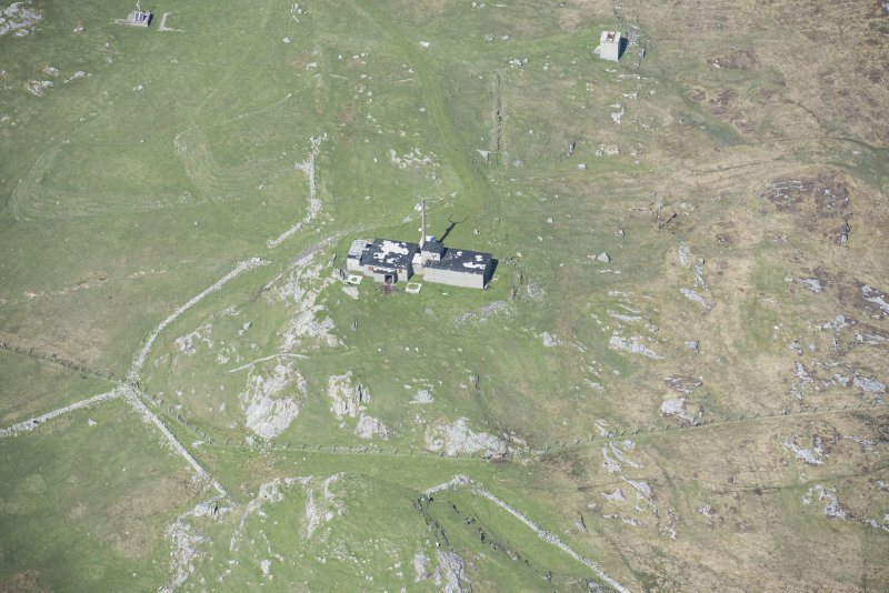 Oblique aerial view of the radar station on Beinn Ghott on the Isle of Tiree, looking NW.