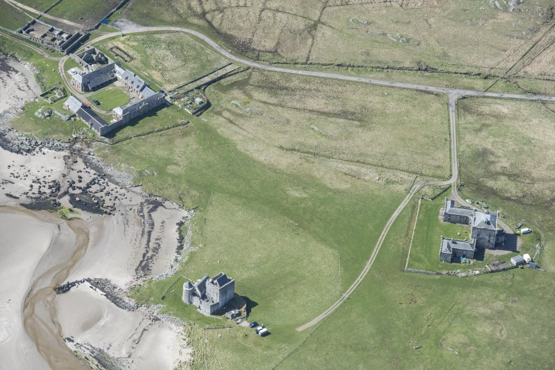 Oblique aerial view of Breachacha House and castle on the Isle of Coll, looking NNW.