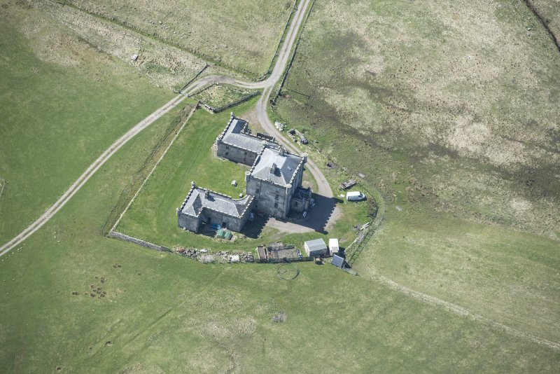 Oblique aerial view of Breachacha House on the Isle of Coll, looking SW.