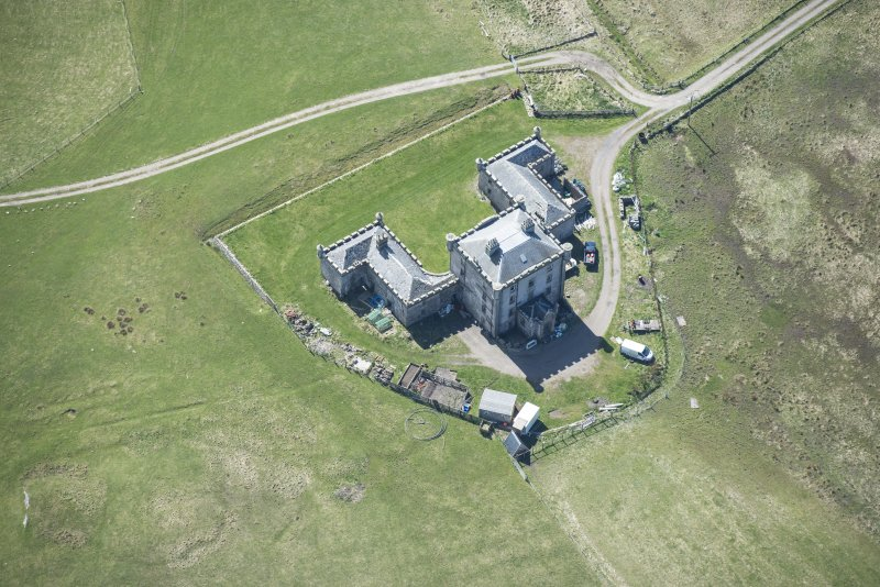 Oblique aerial view of Breachacha House on the Isle of Coll, looking S.