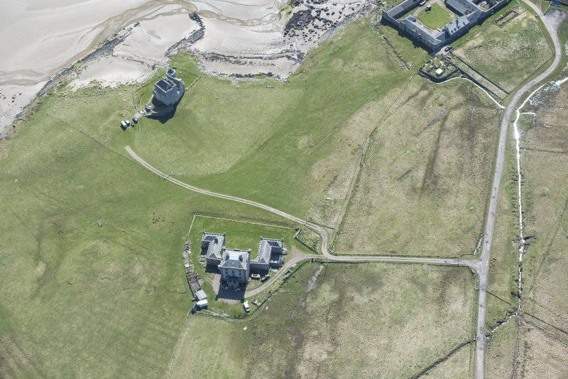 Oblique aerial view of Breachacha House and castle on the Isle of Coll, looking SSE.