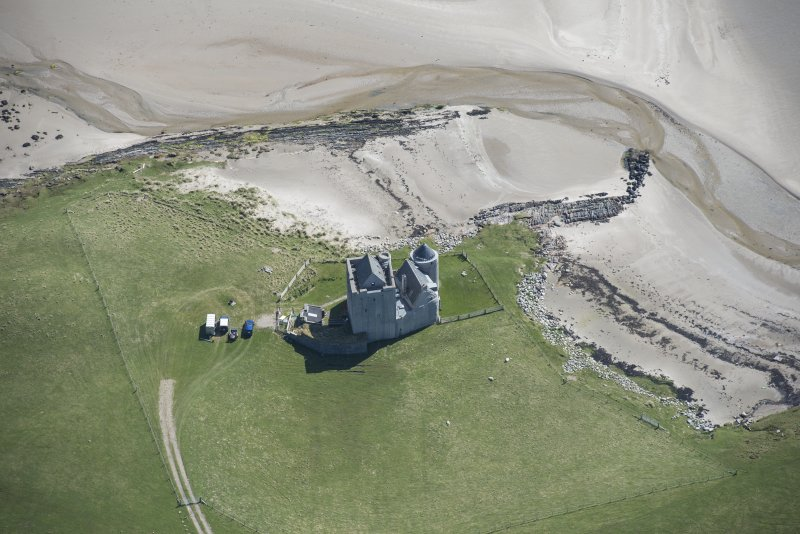 Oblique aerial view of Breachacha Castle on the Isle of Coll, looking ESE.