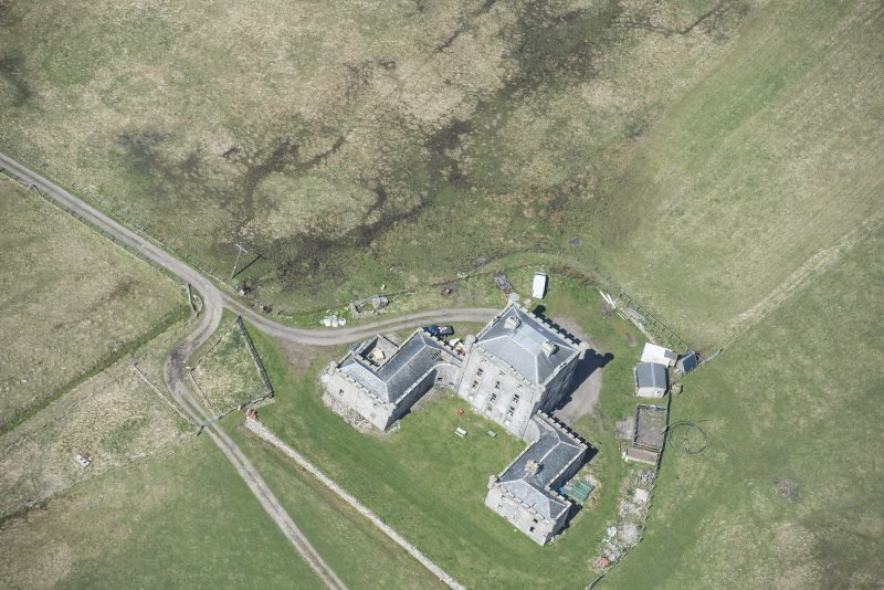 Oblique aerial view of Breachacha House on the Isle of Coll, looking NW.