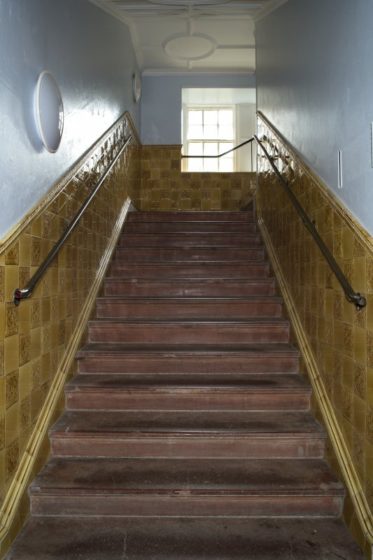 Level 2, gold tiled staircase, view from north