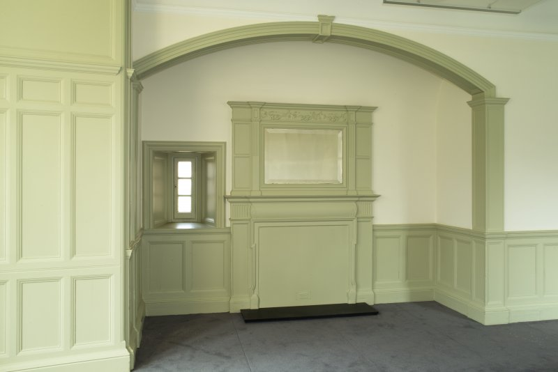 Level 6, south west corner room, view of fireplace in arched recess