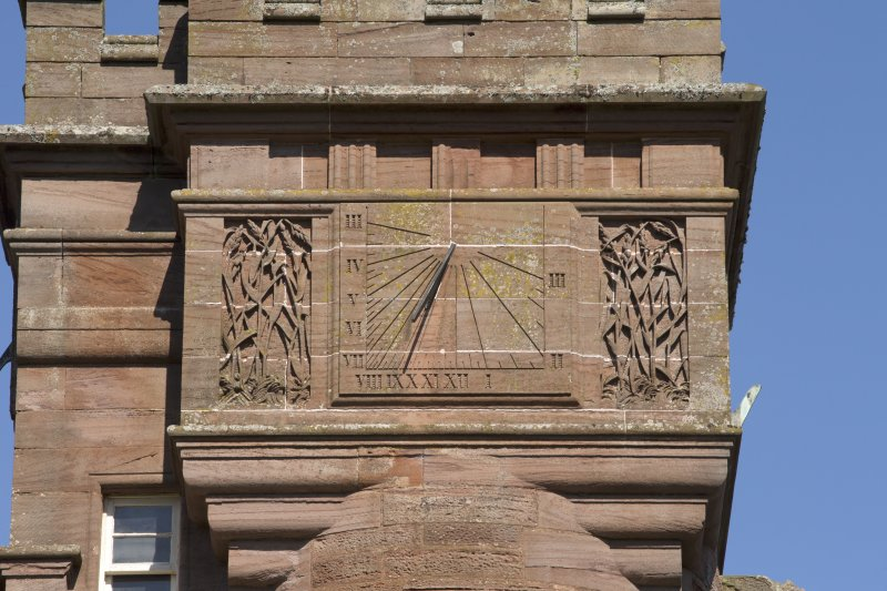 Close detail of south east face of sundial at top of tower