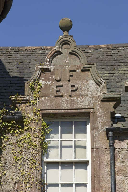 South east facade, detail of pediment with carved initials (JF EP)