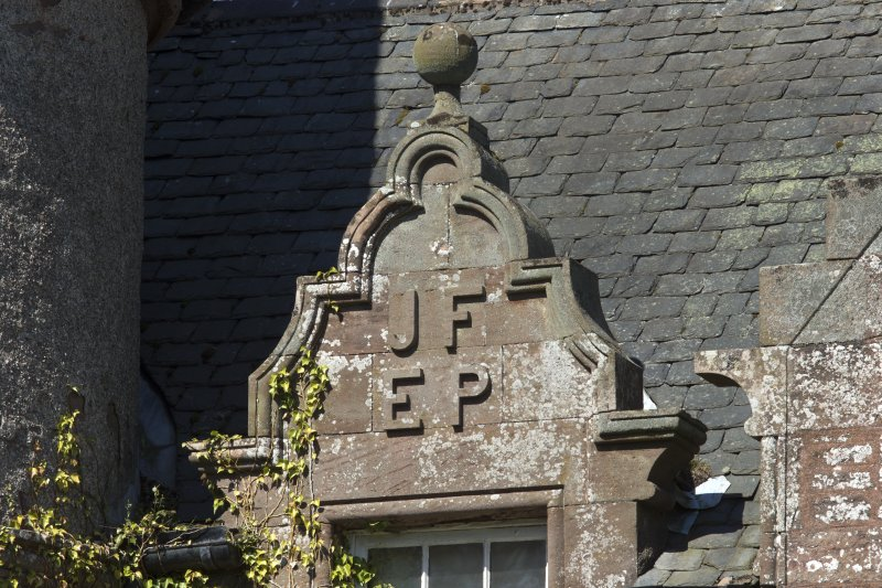 South east facade, detail of pediment above window with carved initials (JF EP)