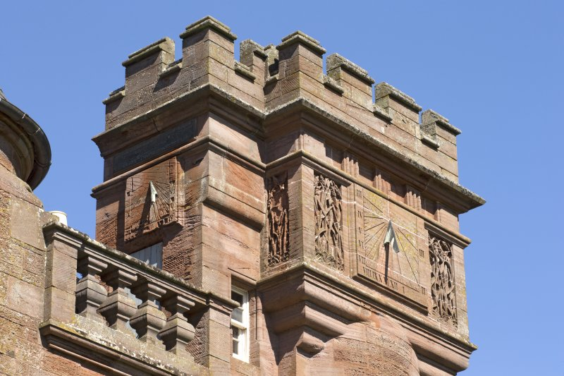 South east facade, sundial on tower, detail of south west and south east faces