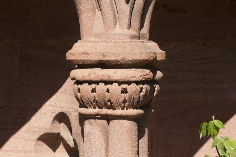Gallery, arched stone seat, detail of carved capital