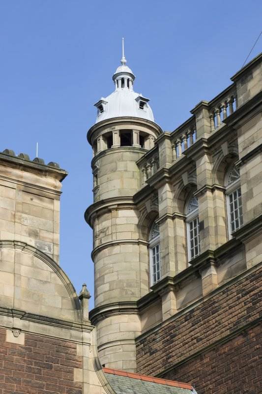 Detail of pediment, turret and windows on main tower, view taken from the south west.