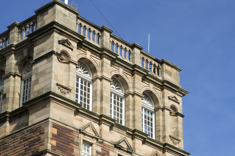 Detail of balustrade, windows and motifs on the main tower, view taken form the south west.