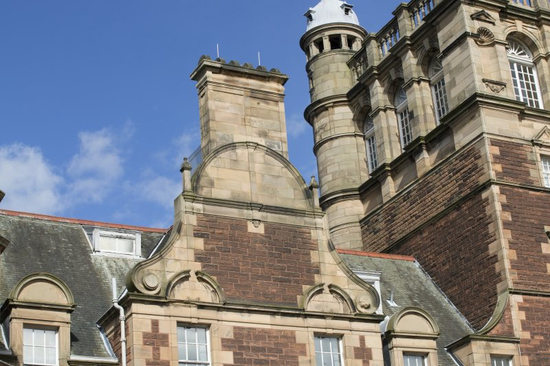 Detail of the chimney stack and pediment on the south elevation of the west wing, view taken from the south west.