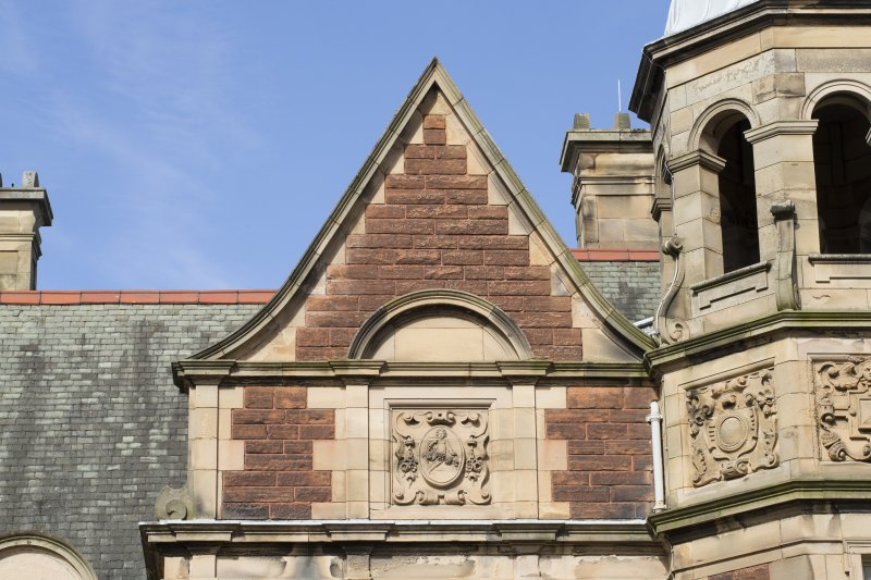 Detail of pediment and motif on the south elevation of the west wing, view taken from the south.