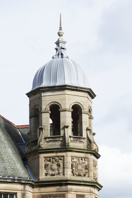 Detail of upper tower, west wing, south elevation.