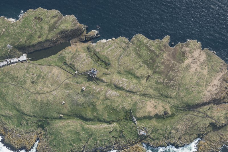 Oblique aerial view of the New Lighthouse, The Beacon, Lighthouse and Keepers Cottage and remains of the Port War Signal Station on the Isle of May, looking SW.