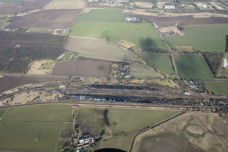 Oblique aerial view of Thornton Marshalling Yard and Corsbie Hall House, looking N.