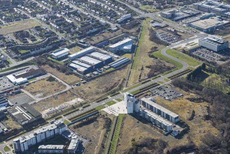 Oblique aerial view of the proposed site for the RCAHMS store, looking S.